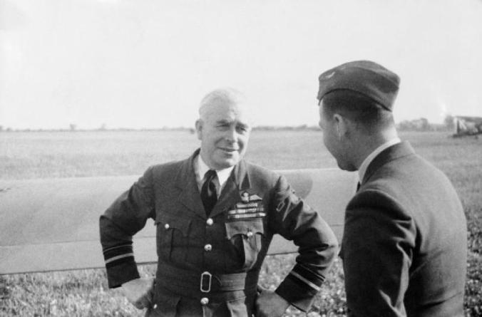 Air_Vice-Marshal_R_E_Saul,_Air_Officer_Commanding_No._12_Group,_Fighter_Command,_talking_to_Wing_Commander_R_B_Lees,_the_station_commander_at_Coltishall,_Norfolk,_July_1941._CH3193
